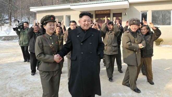 This undated picture, released from North Korea's official Korean Central News Agency (KCNA) on Jan. 23 shows North Korean leader Kim Jong Un visiting a  revolutionary battle site.