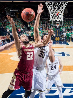 Feb 4, 2015; South Bend, IN, USA; Boston College Eagles guard Aaron Brown (22) and Notre Dame Fighting Irish forward Zach Auguste (30) fight for a rebound in the first half at the Purcell Pavilion. Notre Dame won 71-63. Mandatory Credit: Matt Cashore-USA TODAY Sports