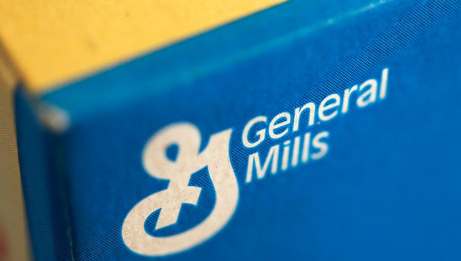 FILE - This Sept. 20, 2011 file photo shows the General Mills logo on a box of Fiber One cereal, in Philadelphia. (AP Photo/Matt Rourke, File)