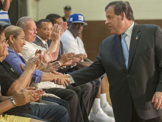 Governor Chris Christie shakes hands with Camden resident Altagracia Sime after Christie delivered a speech on criminal justice reform at the Roberto Clemente North Camden Community Center in Camden on Thursday. 07.16.15