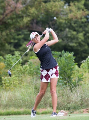 Payton Carter, of Henderson County high school tees off during the Girls Second Regional Golf Tournament at Ben Hawes Golf Course in Owensboro on Monday afternoon.