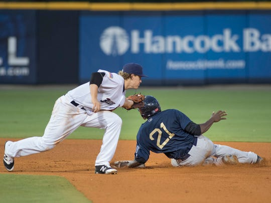 Gabriel Guerrero (21) safely slides into second base ahead of the tag of second baseman Brandon Dixon (27) during the Mobile BayBears vs. Blue Wahoos baseball game at Blue Wahoos Stadium in Pensacola, FL on Wednesday, June 15, 2016.