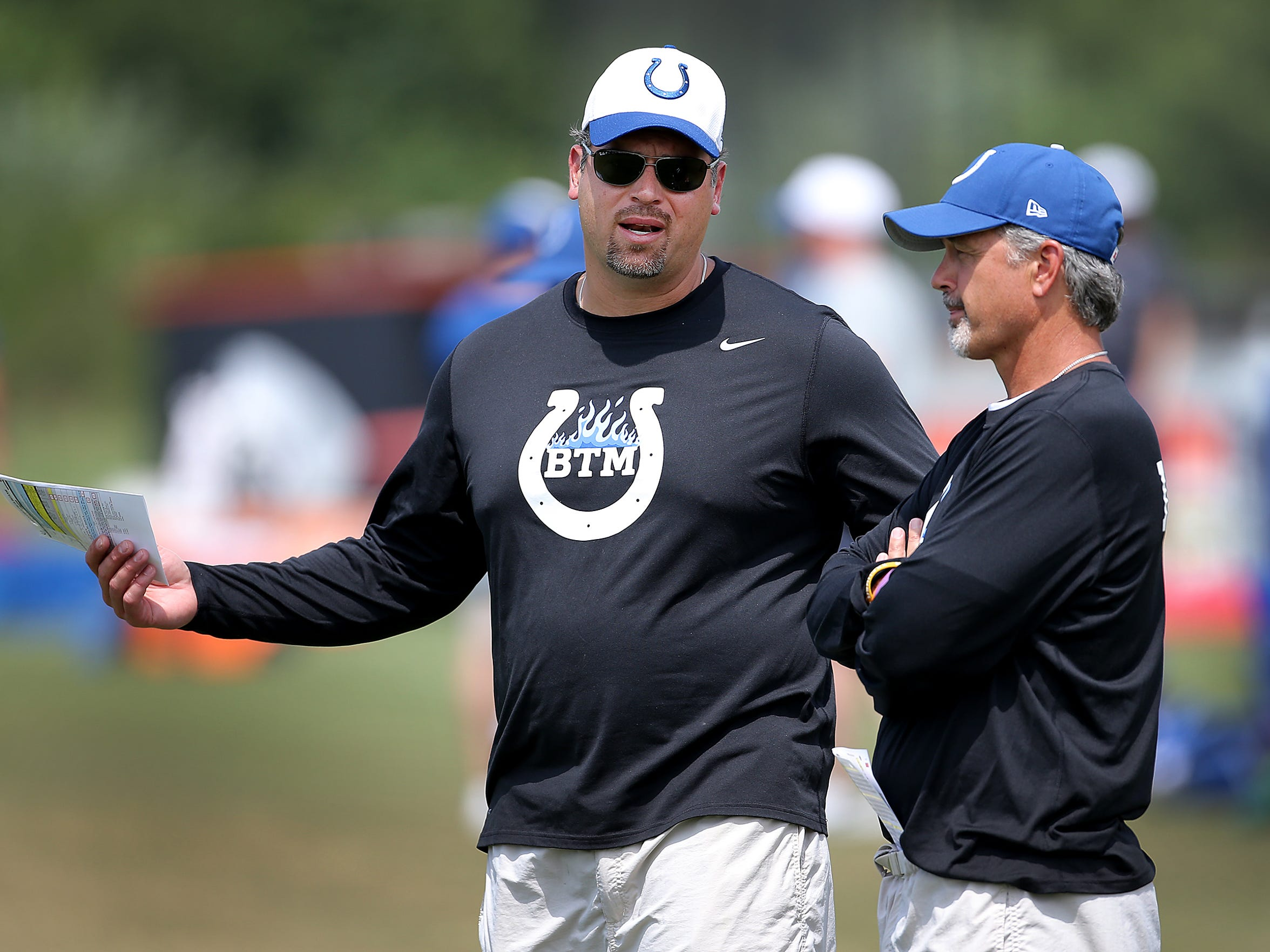 Indianapolis Colts general manage Ryan Grigson (left)  and  coach Chuck Pagano have been leading the team since early 2012.
