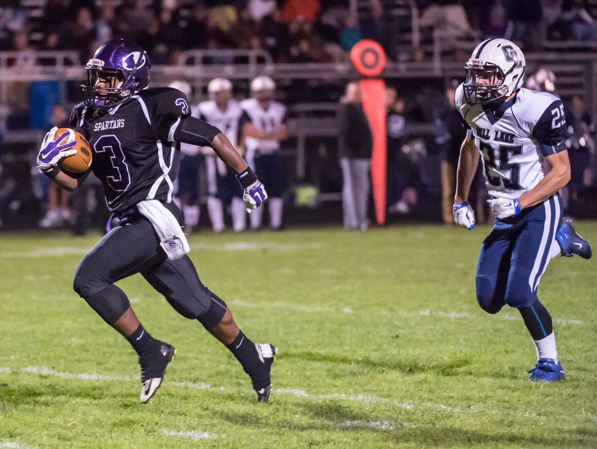 Lakeview's Jay'Vion Settles (3) heads for the goal line against Gull Lake Friday evening
