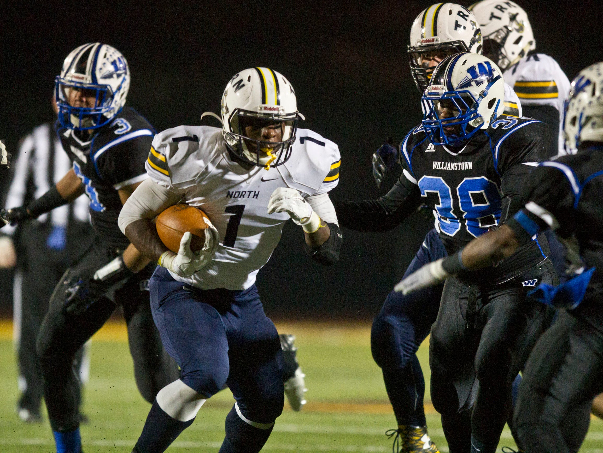 Toms River North's Asante Moorer gains yardage.Toms River North defeats Williamstown for the NJSIAA Group V State Championship title. Glassboro, NJ Saturday, December 5, 2015 @dhoodhood