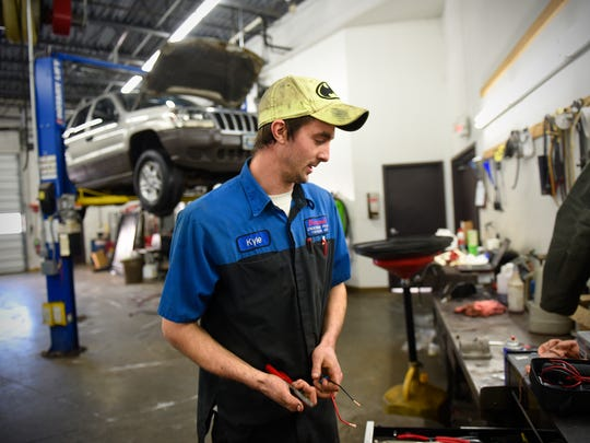 Kyle Bednar  pauses while working Friday, Dec. 18, at Brandl Motors in Little Falls. Bednar survived cardiac arrest when he was 17 during his graduation party.