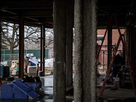 A construction crew continued work on Emens Auditorium