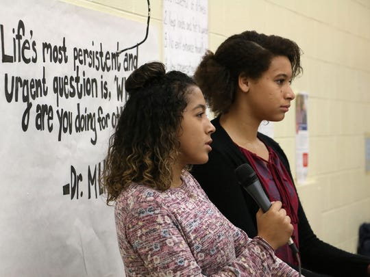 Bullied Yerington teens Jayla Tolliver, left, and Taylissa Marriott thank the students of Swope Middle School for their letters of support while paying them a visit in Reno on Dec. 12, 2017.
