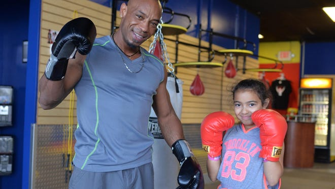 Vila Boxing owner David Anthony poses for a photograph with daughter Samantha Lee Figueroa, 9, inside the new Vineland gym, Monday, Jun. 27, 2016.