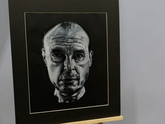 """Addison Arbaugh drew a portrait of his father, Ben Arbaugh. He said he wanted to make the piece intimate, to show his father's love and passion. """"It helped me cope a little bit,"""" he said. It took him about 2 months to finish. It was on display for his father's """"Last Lecture."""""""