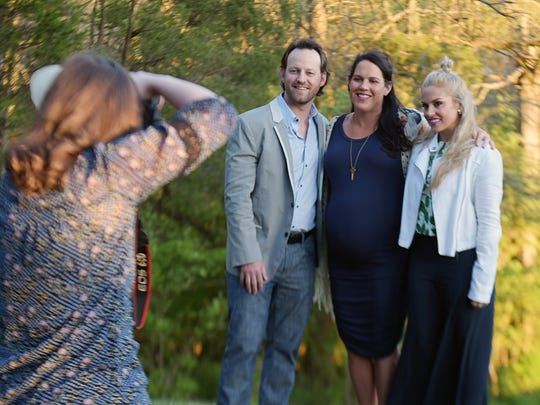Drew and Whitney Britt are pictured with Jamie Howell,