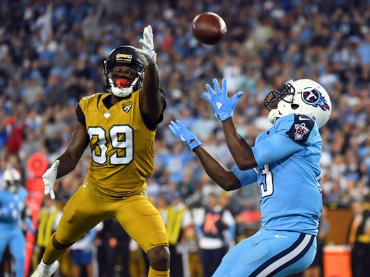 Oct 27, 2016; Nashville, TN, USA; Tennessee Titans wide receiver Kendall Wright (13) catches a touchdown pass behind coverage by Jacksonville Jaguars safety Tashaun Gipson (39) in the first half at Nissan Stadium. Mandatory Credit: Christopher Hanewinckel-USA TODAY Sports