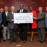 ULM President Nick Bruno, AT&T representatives, and local dignitaries celebrate the donation of $25,000 to the Top Hawks scholarship fund.