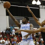 Denver Nuggets' Emmanuel Mudiay, left, goes up for a shot against the Atlanta Hawks' Walter Tavares during the first half of an NBA summer league basketball game earlier this month in Las Vegas.