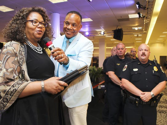 Pastor Henry Coles holds the microphone for Life of