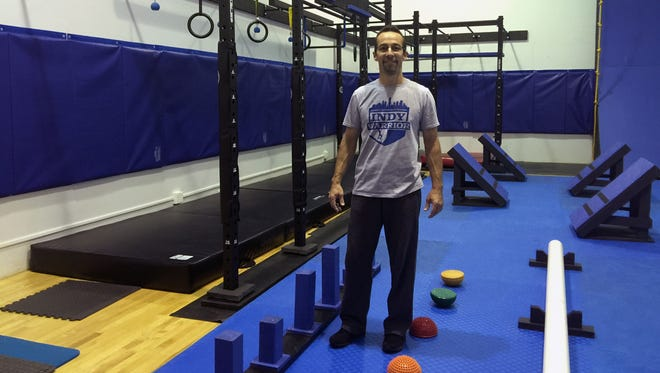 Andy Smith, 46, stands in his new gym, Indy Warrior, 411 S. Harbour Drive, Noblesville.