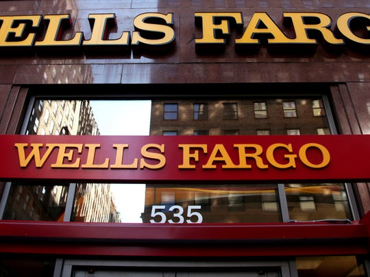 In this May 6, 2012, file photo, a Wells Fargo sign