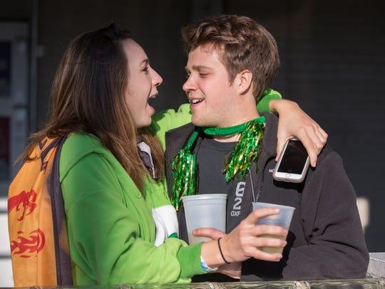Katie Estep, 21, and Ian, 22, celebrate Green Beer