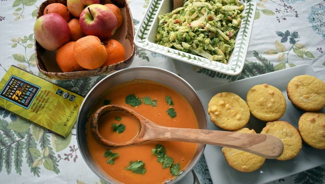 Carrot Coconut Soup, Cornbread Muffins with Roasted Broccoli, Shaved Brussels Sprouts Salad with Brown Butter Dressing and fresh fruit and chocolate for dessert will fill your guests nutritiously.