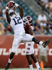 Penn State's Chris Godwin goes high for a catch against Temple during a recent game. Godwin finished with 59 catches for 982 yards and 11 TDs for the Nittany Lions last season.