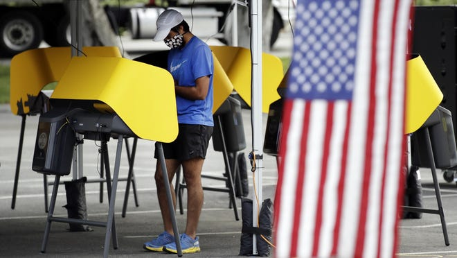 Arjan Walia votes during a special election May 12 in Santa Clarita. California will establish hundreds of in-person voting places across the state for the November election, even in a year when every registered voter will be sent a mail-in ballot because of health concerns over the coronavirus.
