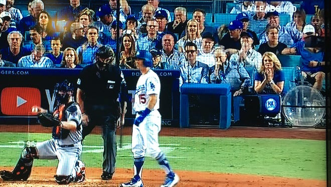 In this screen shot from the Fox TV broadcast of the World Series, you can spot four desert dignitaries in the stands: TV personality Mary Hart, her husband Burt Sugarman, Paul Tollett, the man behind the Coaachella music festival, and Harold Matzner, the man who brings you the Palm Springs International Film Festival.