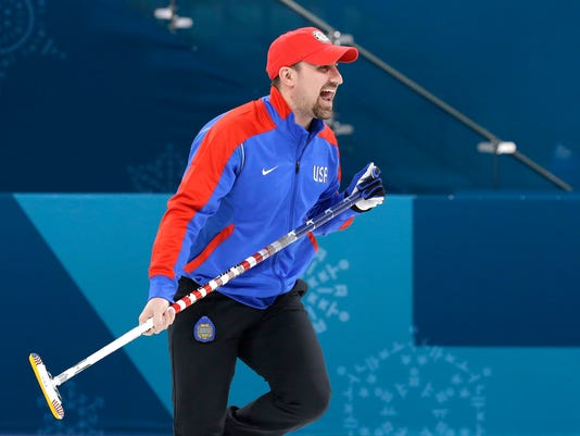 In this Saturday, Feb. 17, 2018 photo,  curler Joe Polo, of the United States, laughs during practice at the 2018 Winter Olympics in Gangneung, South Korea.  Joe and Kristin Polo, both curlers, named their daughter Ailsa, after the Scottish island where the granite that makes curling rocks is mined. (AP Photo/Aaron Favila)