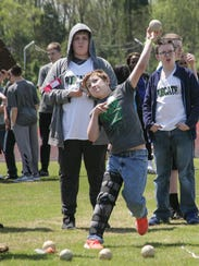A student competes in the Special Olympics in Springfield.