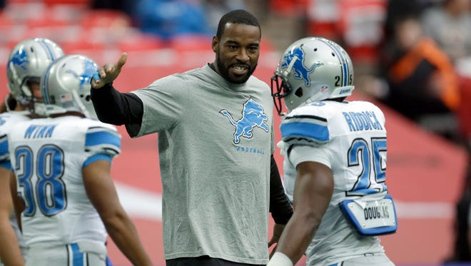 Detroit Lions wide receiver Calvin Johnson shakes hands with running back Theo Riddick before the NFL football game against the Atlanta Falcons at Wembley Stadium, London, Sunday, Oct. 26, 2014.