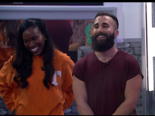 """Dominique Cooper, a University of Tennessee alumna, wears UT attire and stands next to """"Big Brother"""" season 18 runner-up Paul Abrahamian in the """"Big Brother"""" season 19 premiere."""