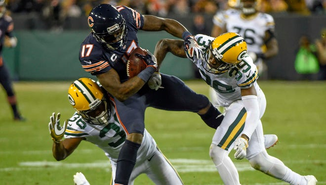 Chicago Bears wide receiver Alshon Jeffery is tackled by Green Bay Packers cornerbacks LaDarius Gunter (36) and Demetri Goodson (39) after making a catch in the second quarter Thursday, Oct. 20, 2016, at Lambeau Field.