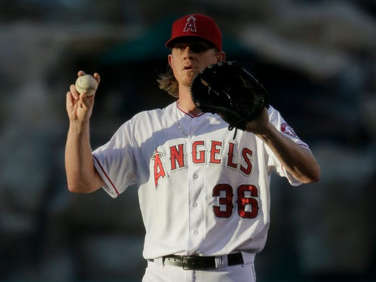 Los Angeles Angels starting pitcher Jered Weaver prepares to throws against the Toronto Blue Jays during the first inning of a baseball game in Anaheim, Calif., Monday, July 7, 2014. Weaver left the game with an injury before the third inning. (AP Photo/Chris Carlson)