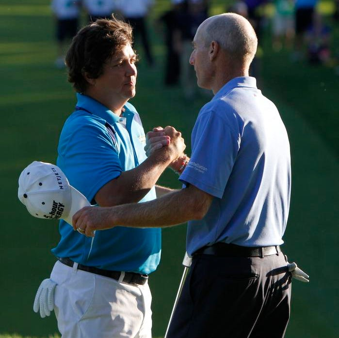 Jason Dufner shakes hands with Jim Furyk after winning the 95th PGA Champion-<240>ship at Oak Hill in Pittsford on Sunday.