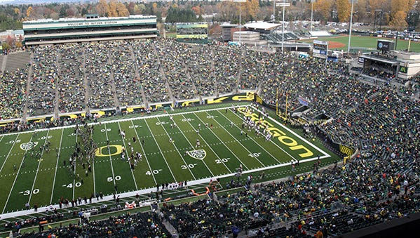 Fans arrive before the 115th Civil War football game between Oregon and Oregon State at Autzen Stadium in Eugene on Saturday, Nov. 26, 2011.
