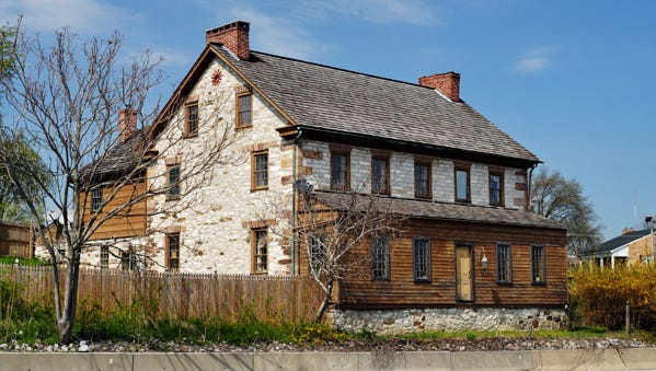 The historic Peter Wolf house sits along the Lincoln Highway.