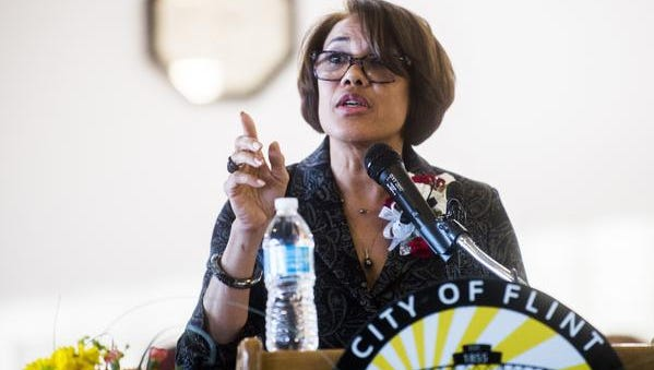 Flint Mayor Karen Weaver won over City Council member Scott Kincaid in a recall election involving 18 candidates, keeping alive the city's proposed 30-year agreement with the Detroit water system.