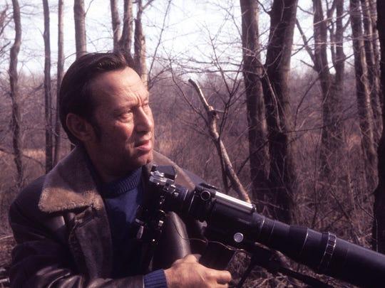 Arthur Singer, bird painter and avid photographer.