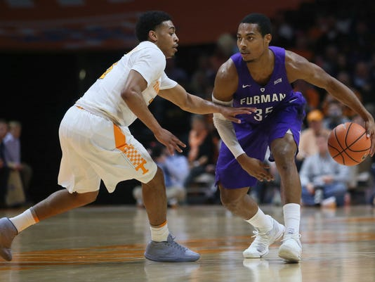 Furman guard Daniel Fowler (35) is defended by Tennessee guard James Daniel III, left, in the second half of an NCAA college basketball game Wednesday, Dec. 20, 2017, in Knoxville, Tenn. (AP Photo/Crystal LoGiudice)