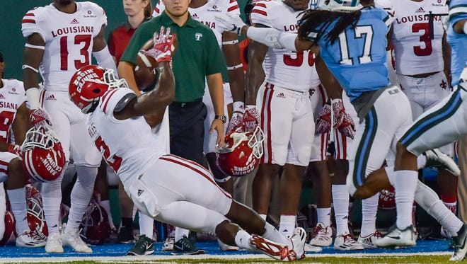 UL receiver Al Riles makes a catch near the sideline for a first down in Saturday's loss to Tulane.