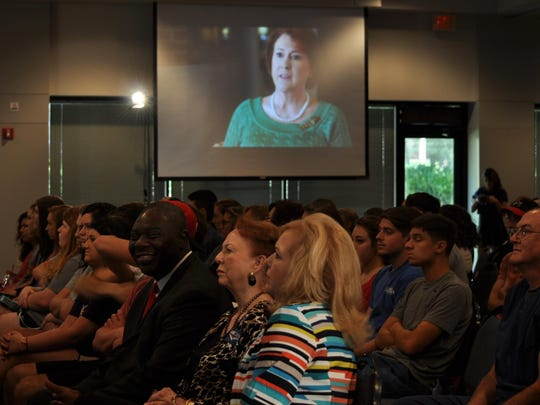 Members of the public join faculty and students of Louisiana College in Pineville to hear from Janet Huckabee, wife of GOP presidential candidate Mike Huckabee, on Wednesday.