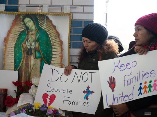 Supporters gather to rally for the Campos family Wednesday, Dec. 6, 2017 outside Sen. Cory Booker's office building in Camden, New Jersey. Oscar and Humberta Campos are facing deportation back to Mexico, and have three children that would be left behind.