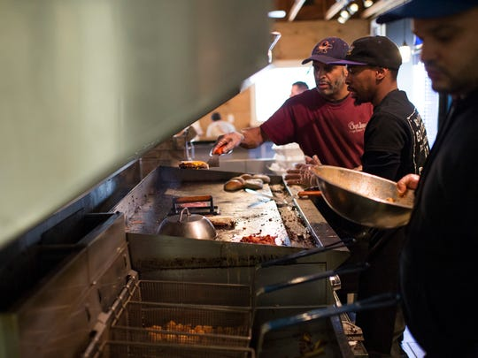 Workers at the grill at Outlaw's Burger Barn & Creamery in 2018.