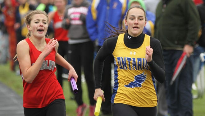 Ontario's Rachel Miller passes Shelby's Makenna Heimlich at the finish line to win the 4x400 meter relay in Saturday's Northern Ohio League meet.