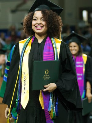 Vanessa Lynn Fernandez celebrates graduating Sunday during FGCU's commencement at Alico Arena in Fort Myers.