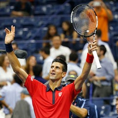 Novak Djokovic of Serbia waves to the crowd after his