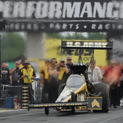 Tony Schumacher, the Top Fuel Champion at the 2012 U.S. Nationals, celebrates in the Winner's Circle at Lucas Oil Raceway on Sept. 9, 2012.