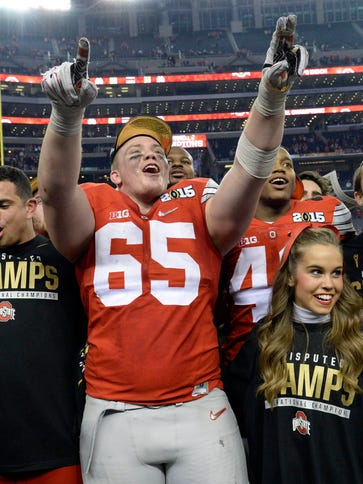 Offensive lineman Pat Elflein (65) and Ohio State ended