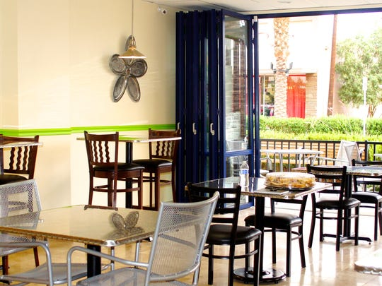 A view of the patio from the Deli on Miles dining room.