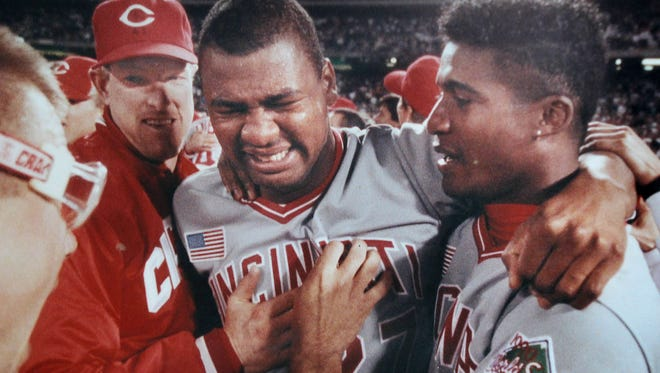 (l-r) Chris Sabo, Norm Charlton, MVP Jose Rijo and Mariano Duncan celebrate the Reds 1990 World Series sweep of the Oakland A's on the field after the final game in Oakland.