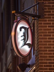 The sign outside of Lachey's Bar at 12th and Walnut